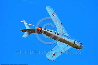 WB-MiG-17 00021 Bottom view of a banking flying Mikoyan-Guryevich MiG-17 Fresco Soviet Cold War era supersonic jet fighter in afterburner warbird in Polish Air Force markings at Thunder Over Michigan 2016 airshow warbird picture by Peter J  Mancus