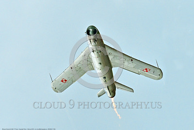 WB-MiG-17 00034 Bottom view of a flying Mikoyan-Guryevich MiG-17 Fresco Soviet Cold War era supersonic jet fighter in afterburner warbird in Polish Air Force markings at Thunder Over Michigan 2016 airshow warbird picture by Peter J  Mancus