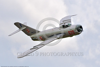 WB-MiG-17 00038 A flying Mikoyan-Guryevich MiG-17 Fresco Soviet Cold War era supersonic jet fighter in Polish Air Force markings in cloudy skies at Thunder Over Michigan 2016 airshow warbird picture by Peter J  Mancus