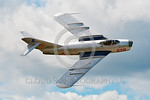 WB-MiG-17 00013 Top view of a banking flying Mikoyan-Guryevich MiG-17 Fresco Soviet Cold War era supersonic jet fightr warbird in Polish Air Force markings at Thunder Over Michigan 2016 airs ...