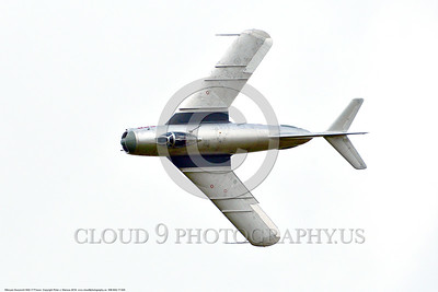WB-MiG-17 00025 Top view of a banking flying Mikoyan-Guryevich MiG-17 Fresco Soviet Cold War era supersonic jet fighter warbird at Thunder Over Michigan 2016 airshow warbird picture by Peter J  Mancus