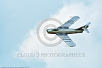 WB-MiG-17 00029 Top view of a banking flying Mikoyan-Guryevich MiG-17 Fresco Soviet Cold War era supersonic jet fighter warbird in Polish Air Force markings at Thunder Over Michigan 2016 air ...