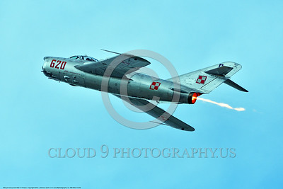 WB-MiG-17 00053 A flying Mikoyan-Guryevich MiG-17 Fresco Soviet Cold War era supersonic jet fighter in afterburner and Polish Air Force markings warbird at Thunder Over Michigan 2016 airshow warbird picture by Peter J  Mancus