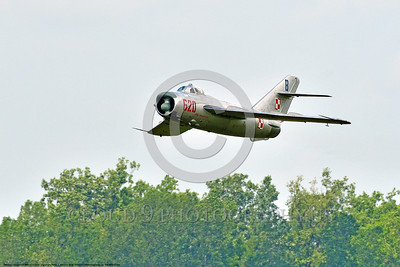 WB-MiG-17 00037 A low flying Mikoyan-Guryevich MiG-17 Fresco Soviet Cold War era supersonic jet fighter in Polish Air Force markings in cloudy skies at Thunder Over Michigan 2016 airshow warbird picture by Peter J  Mancus