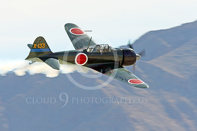 WB-Mitsubishi A6M Zero 00004 A smoking descending flying Mitsubishi Zero WWII Japanese fighter simulates battle damage warbird picture by Peter J Mancus