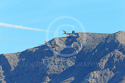 WB-F-86 00016 Two North American Sabre USAF Korean War era jet fighters fly low as if chasing an enemy plane feeing them, warbird picture by Peter J Mancus