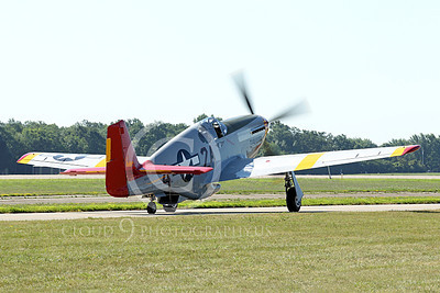 WB - North American P-51 Mustang 00215 A Tuskegee Airmen North American P-51 Mustang warbird taxis at the Oshkosh 2011 airshow, by Peter J Mancus