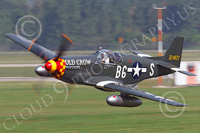 WB - North American P-51 Mustang 00110 A North American P-51 Mustang US Army Air Force World War II era fighter, painted in an ace's markings as Old Crow, makes a low pass, by Peter J Mancus