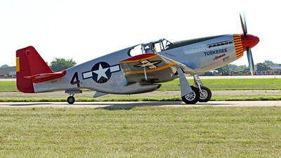 WB - North American P-51 Mustang 00041A A taxing Tuskegee Airmen North American P-51 Mustang World War II era fighter, by Peter J Mancus