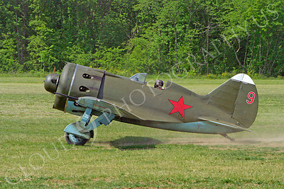 WB - Polikarpov I-16 00011 A World War II era Polikarpov I-16 warbird fighter plane in Soviet markings taxis on a grass field, by Stephen W D Wolf