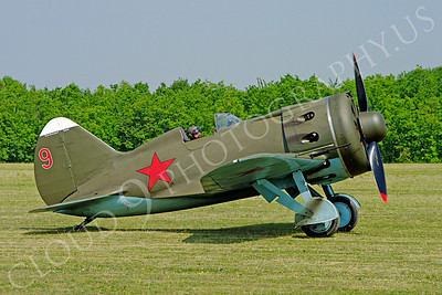 WB - Polikarpov I-16 00009 A World War II era Polikarpov I-16 warbird fighter plane in Soviet markings takis on a grass field, by Stephen W D Wolf
