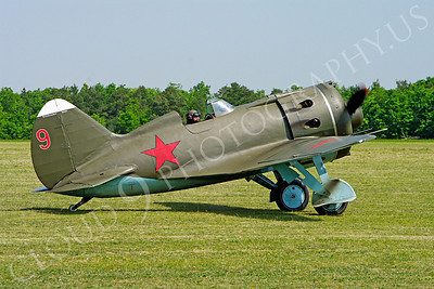 WB - Polikarpov I-16 00013 A World War II era Polikarpov I-16 warbird fighter plane in Soviet markings taxis on a grass field, by Stephen W D Wolf