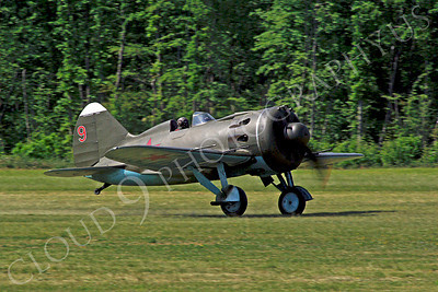 WB - Polikarpov I-16 00001 A World War II era Polikarpov I-16 warbird fighter plane in Soviet markings takes off from a grass field, by Stephen W D Wolf