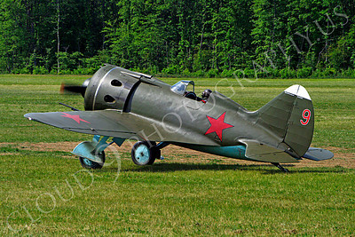 WB - Polikarpov I-16 00005 A World War II era Polikarpov I-16 warbird fighter plane in Soviet markings taxis for a take off from a grass field, by Stephen W D Wolf