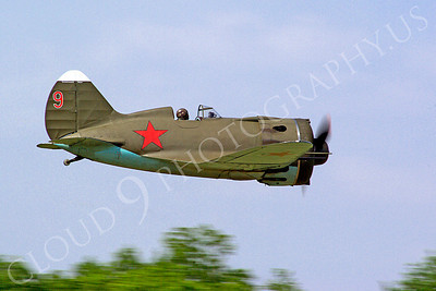 WB - Polikarpov I-16 00002 A World War II era Polikarpov I-16 warbird fighter plane in Soviet markings makes a high speed gear up low pass, by Stephen W D Wolf