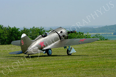 WB - Polikarpov I-16 00010 A World War II era Polikarpov I-16 warbird fighter plane in Soviet markings taxis on a grass field, by Stephen W D Wolf