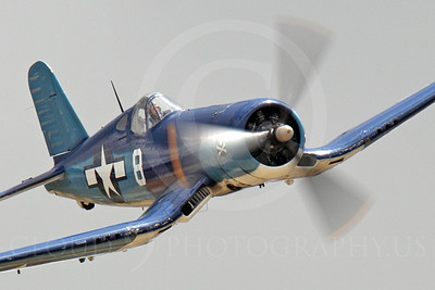 WB - Chance Vought F4U Corsair 00027 Tight crop of a flying Chance Vought F4U Corsair WWII era fighter warbird with pirate nose art, airplane picture, by Peter J Mancus