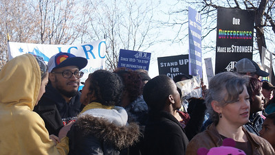 Crowd of people waiting to march on MLK Day in Denver.