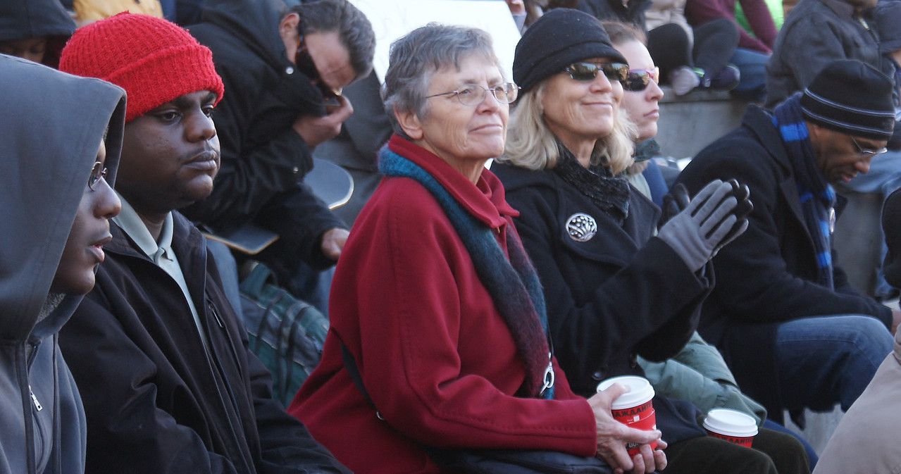 Senior women and young men, among spectators at MLK Day rally in Denver.