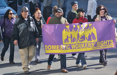 Domestic workers marching with banner in MLK Day parade in Denver.