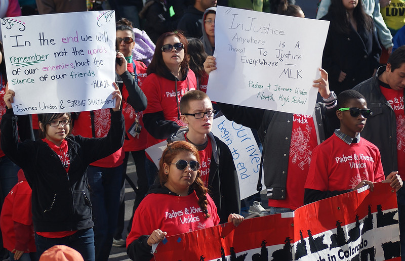High schoool students marching in MLK Day parade in Denver.