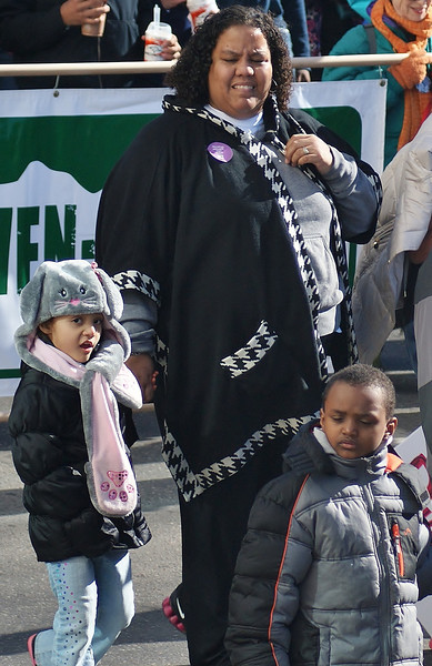African -American mother with two children at MLK Day parade in Denver.