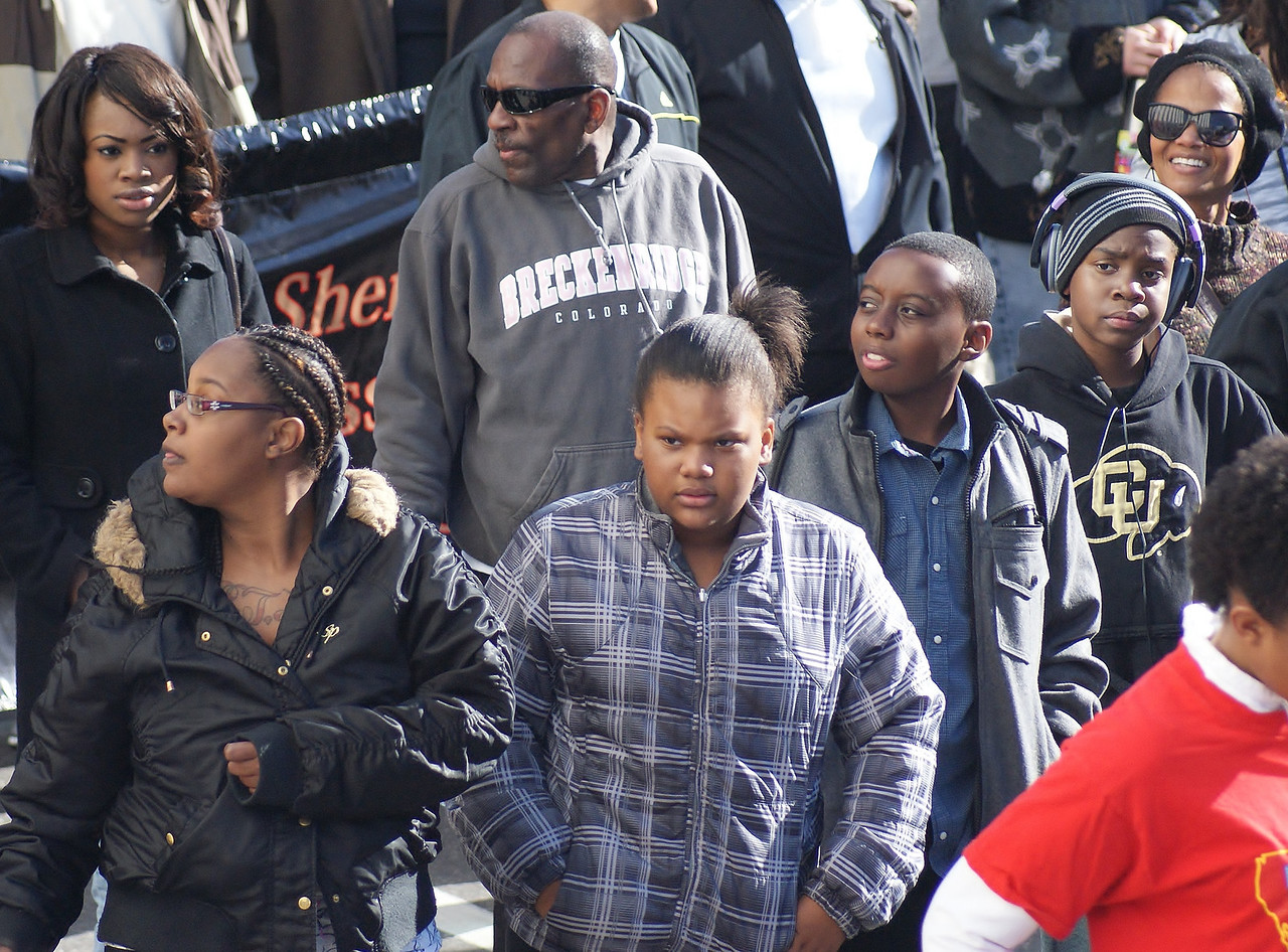 African-American family marching in MLK Day parade in Denver.