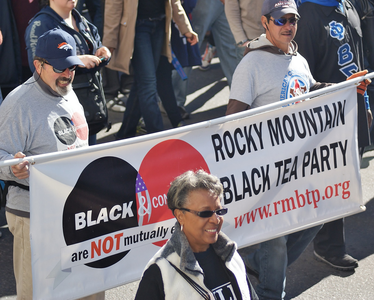 """Marchers with """"Black Tea Party"""" banner in MLK Day parade in Denver."""