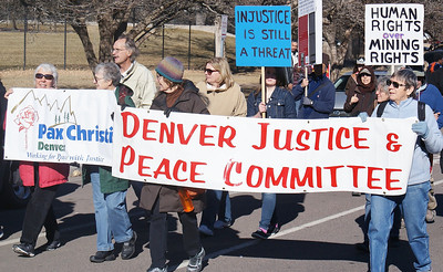 These peace and justice activists were among the marchers in the MLK Day parade in Denver.