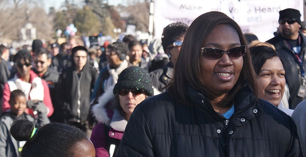 Young African-American woman marching in Denver on MLK Day.