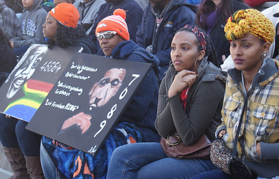 African-American man with sign with image of Martin Luther King and his prisoner number from the Birmingham, Al jail, at MLK Day parade in Denver.