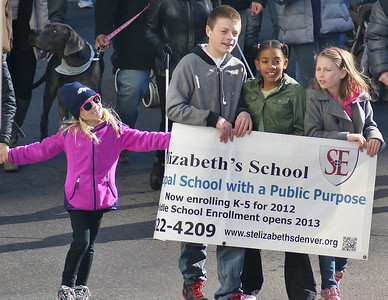 These kids display their schools banner during the MLK Day parade in Denver.