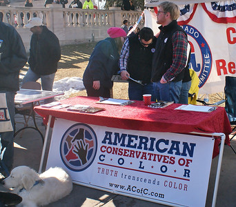 """American Conservatives of Color"" at the MLK Day rally in Denver."