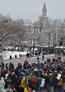 Large group of MLK Day attendees march near the Denver City/County Building.