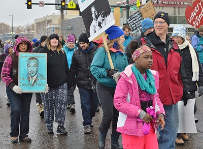 Young African American girl marching in MLK Day parade.
