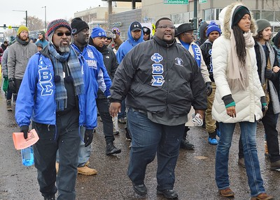 Fraternity members marching in MLK Day parade.