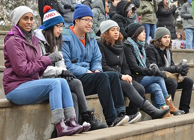 Group of young men and women listen to speakers at MLK Day rally in Denver.