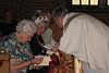 Leslie coordinates with Dorothy and Renate for their duties as oblation bearers.