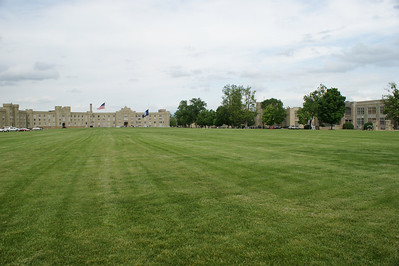 View over the parade grounds at VMI, looking towards the barracks and Stonewall's Statue. Photo by Allissa Weber.