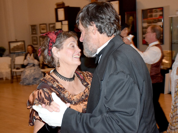 Peggy Whitney, left, and her husband, Scott L. Whitney, right, portrayed First Lady Julia Boggs Dent Grant and President Ulysses S. Grant during the 1872 Courthouse Celebration and Civil War Era Grand Ball Saturday night at the Effingham County Cultural Center and Museum in downtown Effingham.  Dancers filled the upper floor of the Old Effingham County Courthouse. Charles Mills photo