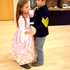 Dressed in period clothing, Rebecca King, left, and her brother, Vincent King, right, both of Orchardville, learn how to Waltz during the 1872 Courthouse Celebration and Civil War Era Grand Ball held at the Effingham County Cultural Center and Museum held at the Old Effingham County Courthouse in downtown Effingham.  Charles Mills photo