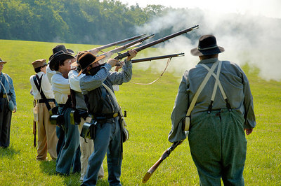 Stock image of Confederate infantry reenactors practicing firing rifles at the American Civil War reenactment of Morgan's Raid on Georgetown, Kentucky.  This was to commemorate Brigadier General John Hunt Morgan's cavalry raid by the Kentucky Brigade of the Confederate Army of Tennessee on the town in 1862 and subsequent two day battle with Federal troops.