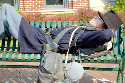 Stock image of American Civil War Union soldier at rest on a street bench at the reenactment of Morgan's Raid on Georgetown, Kentucky.  This was to commemorate Brigadier General John Hunt Morgan's cavalry raid by the Kentucky Brigade of the Confederate Army of Tennessee on the town in 1862 and subsequent two day battle with Federal troops.