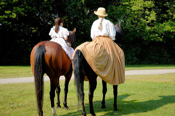 Stock image of Civil War lady reenactors on horses while wearing dresses.  This was at the American Civil War reenactment of Morgan's Raid on Georgetown, Kentucky to commemorate Brigadier General John Hunt Morgan's cavalry raid by the Kentucky Brigade of the Confederate Army of Tennessee on the town in 1862 and subsequent two day battle with Federal troops.