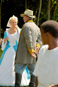 Stock image of young black boy looking at a Confederate cavalry officer and lady friend reenactors at the American Civil War reenactment of Morgan's Raid on Georgetown, Kentucky.  This was to commemorate Brigadier General John Hunt Morgan's cavalry raid by the Kentucky Brigade of the Confederate Army of Tennessee on the town in 1862 and subsequent two day battle with Federal troops.