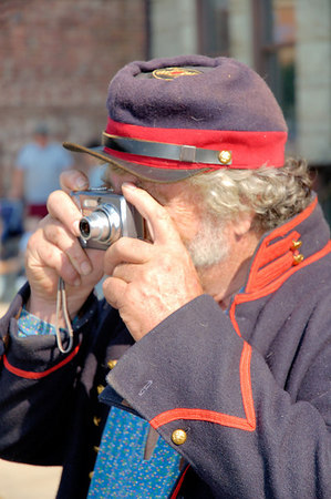 Stock image of Union soldier reenactor taking a picture of the action.  This was during the American Civil War reenactment of Morgan's Raid on Georgetown, Kentucky.  to commemorate Brigadier General John Hunt Morgan's cavalry raid by the Kentucky Brigade of the Confederate Army of Tennessee on the town in 1862 and subsequent two day battle with Federal troops.