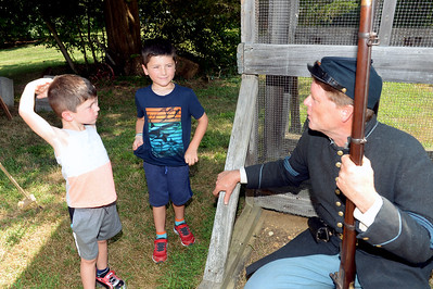 Luca and Bobby Semarano of Brick, NJ visit with their Grandfather, Jim Heine during the 61st NY Regiment Civil War Encampment held at the Havens Homestead, in Brick, NJ on 08/04/2019. (STEVE WEXLER/THE OCEAN STAR).