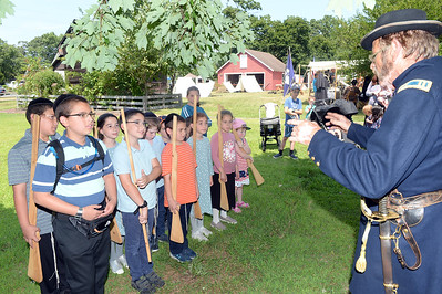 Captain William Johnson and area kids who were invited to participate in the Civil War Encampment hosted by the 61st NY Regiment, held at the Havens Homestead, in Brick, Nj on 08/04/2019. (STEVE WEXLER/THE OCEAN STAR).