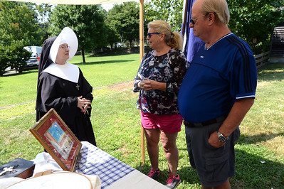 Judith Buncher portraying Sister Veronica with Arlene Valha and Richard Bavier of Brick, NJ looking on, during the Civil War Encampment at the Havens Homestead Museum, in Brick, Nj on 08/04/2019. (STEVE WEXLER/THE OCEAN STAR).