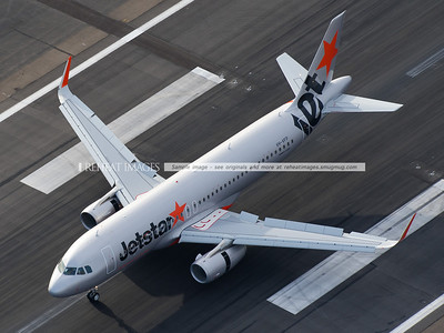 A Jetstar A320-200 VH-VFP with the new Sharklets (winglets) has landed at Sydney airport on runway 34L. The brakes are now on, spoilers deployed and thrust reverse is also called on to slow it down.